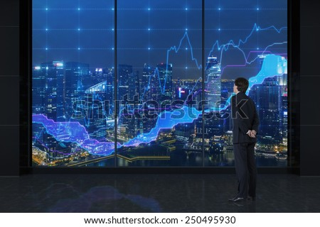 businessman looking to charts and view on city - stock photo