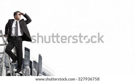 Businessman looking to horizon over urban background. - stock photo