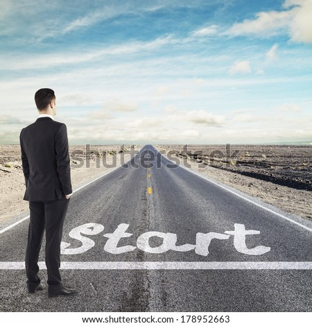 businessman looking to horizont before start line