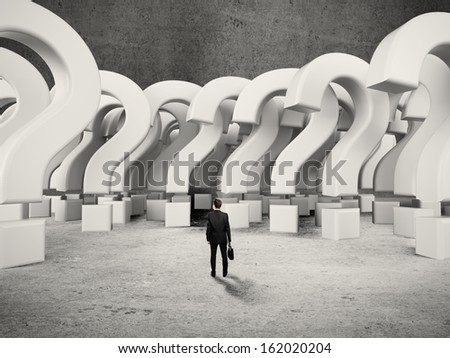 businessman looking to many questions marks - stock photo