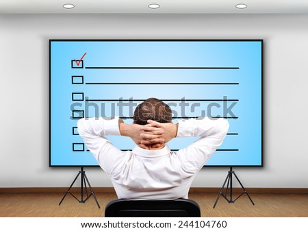 businessman looking to plasma panel with  application form - stock photo