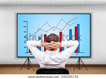 businessman looking to plasma panel with chart - stock photo