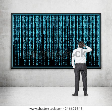 businessman looking to screen with matrix background - stock photo