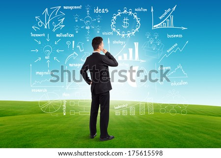 Businessman looking to the future creative drawing charts and graphs business success strategy plan idea, on blue sky and green grass background - stock photo