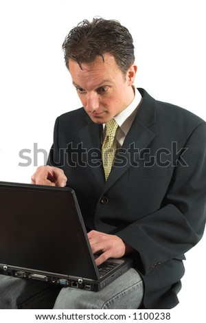 Businessman looking totally shocked at his computerscreen