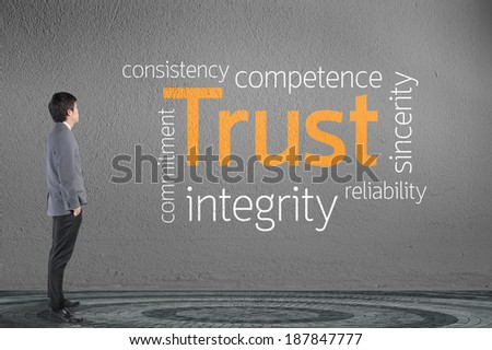 Businessman looking Trust text wording concept