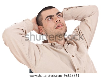 Businessman looking up and relaxing with hands behind head - stock photo