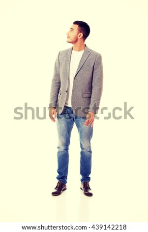 Businessman looking up for copyspace or something - stock photo