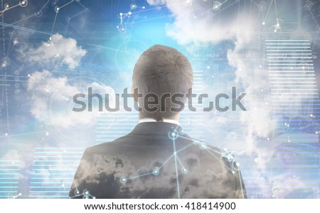 Businessman looking up in suit against hologram background - stock photo