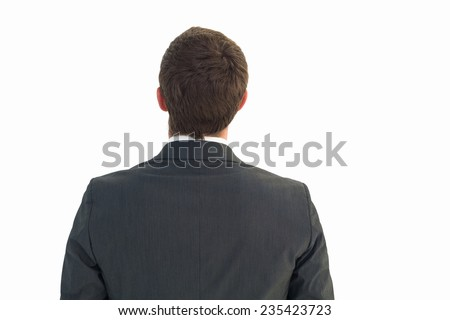 Businessman looking up in suit on white background