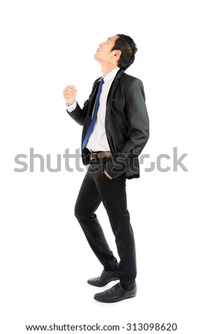 Businessman looking up isolated on over white background - stock photo