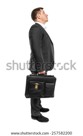 Businessman looking up isolated over white background - stock photo