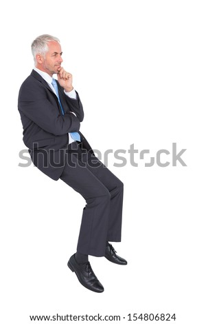 Businessman looking up while thinking on white background - stock photo