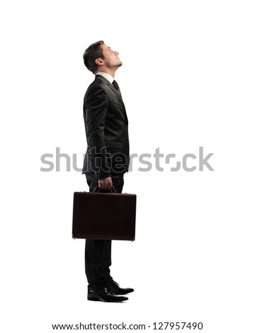 businessman looking upward - stock photo