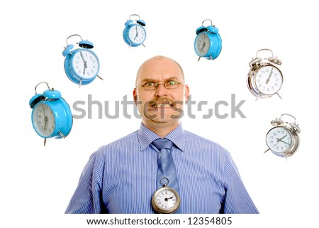 Businessman looking very stressed while various clocks are swirling around his head