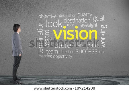 Businessman looking vision text wording in cloud concept