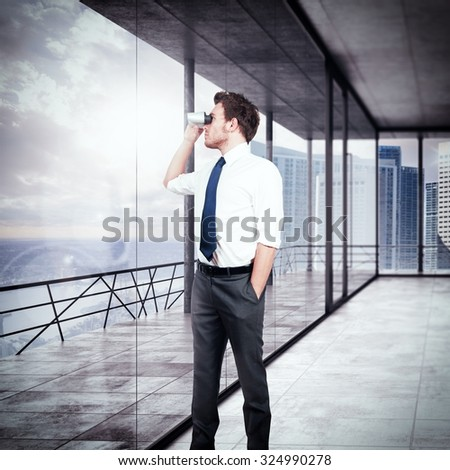 Businessman looking with binoculars from his office - stock photo