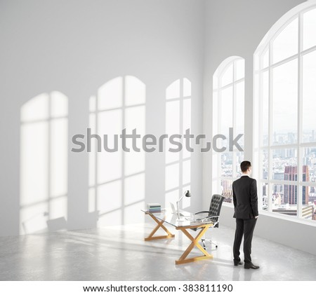 Businessman looks out the window in loft interior room with glassy table and big window at sunset, 3D Render - stock photo