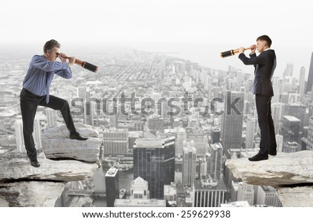Businessman looks through a telescope. Concept for business - stock photo