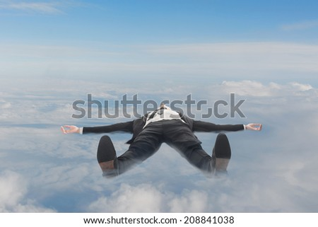 Businessman lying on clouds in sky. - stock photo