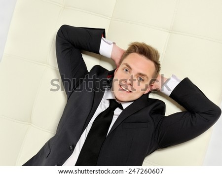 Businessman lying on the couch. Business well, life is good.