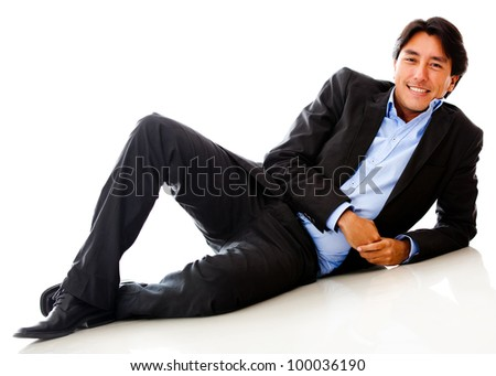 Businessman lying on the floor - isolated over a white background