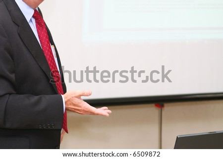 Businessman makes speech in the boardroom - stock photo