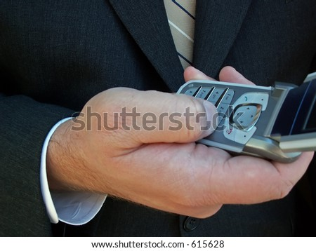 businessman making a call on a cell phone - stock photo