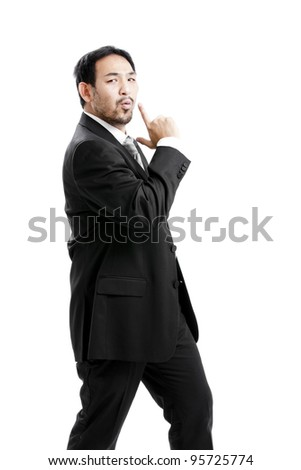 businessman making a gun gesture. Isolated on white - stock photo