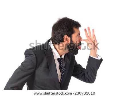 Businessman making a joke over white background
