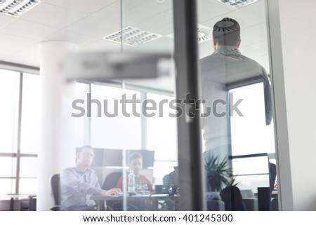 Businessman making a presentation at office. Business team leader delivering a presentation to his colleagues during meeting or in-house business training. - stock photo