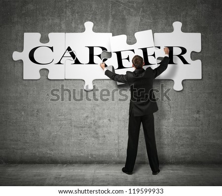 Businessman making a puzzle on the wall with the word Career