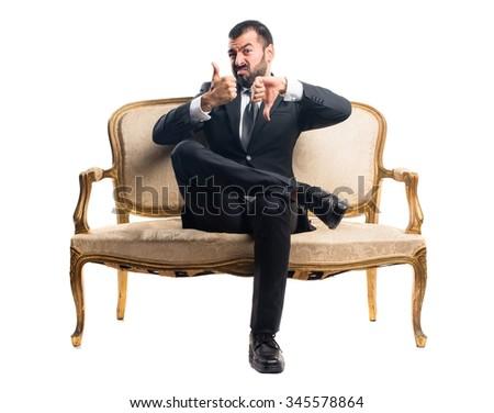 Businessman making good-bad sign - stock photo