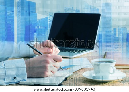 Businessman making notes, laptop and coffee aside. Only hands seen. Double exposure, Singapore. Concept of work. - stock photo