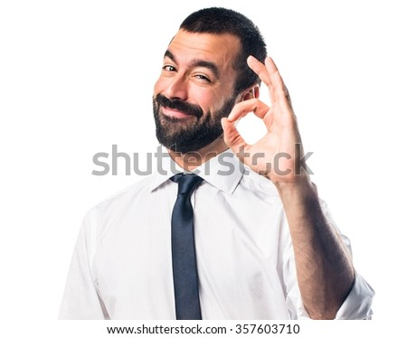 Businessman making OK sign - stock photo