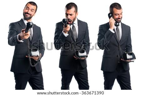 Businessman making phone gesture - stock photo