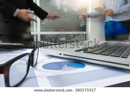 Businessman making presentation with his colleagues and business strategy digital layer effect at the office as concept