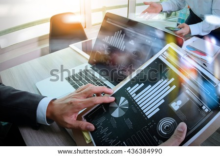 Businessman making presentation with his colleagues and business tablet digital computer at the office as concept