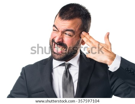 Businessman making suicide gesture