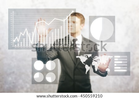 Businessman managing abstract business diagram on concrete background - stock photo