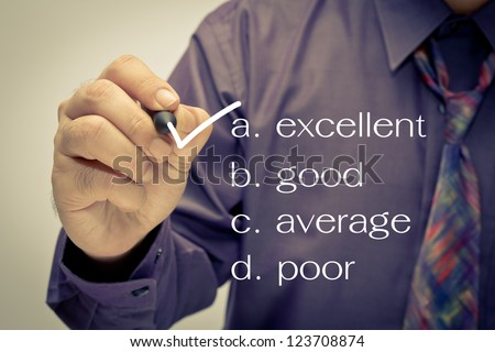 Businessman mark on audit checklist - stock photo