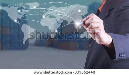 Businessman mark point on world map concept exports to the world, Business success strategy plan on  container yard background (Elements of this image furnished by NASA)