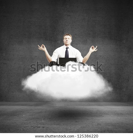 businessman meditating on a cloud in concrete room - stock photo