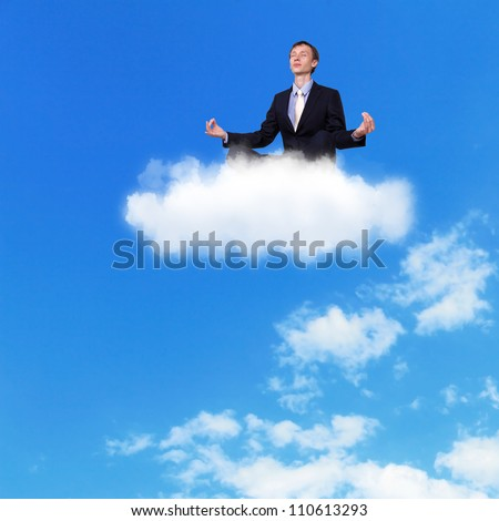Businessman meditating sitting on the white cloud