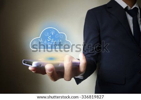 Businessman mobile holding cloud computing  in hand , business concept ,business idea