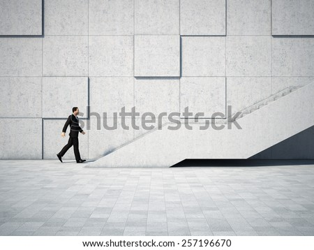 Businessman moving forward and up the stairs - stock photo