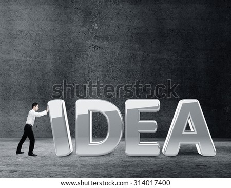 businessman moving word idea in concrete room - stock photo