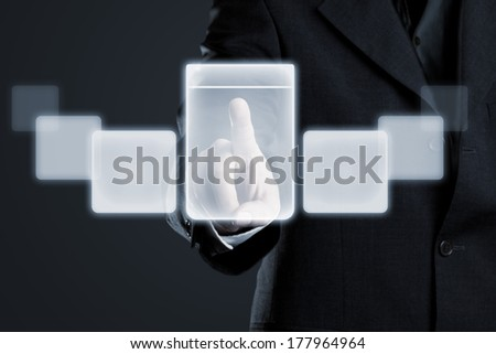 Businessman navigating documents on futuristic touchscreen