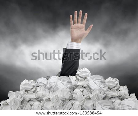 businessman need help from crumpled paper