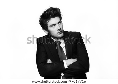 businessman not looking to happy about something looking away in the distance with his arms crossed